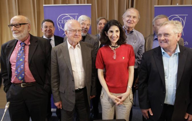 British physicist Higgs poses with other scientists after a news conference update in the search for the Higgs boson at the CERN in Meyrin